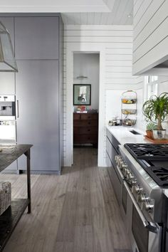 Farmhouse Style, Two Ways Gray & White French oak floors simple and clean.