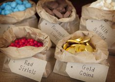 """We love the props like the pirate ship sails, the treasure box, and wooden crates. It looks like the birthday boy scored some """"gold"""" at his birthday party! Scroll down for the vendor credits."""