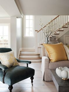 """Light floors throughout the home are an engineered, prefinished product by Navarre; the top layer is real distressed oak, in """"Montauban"""" colorway.  Sweeping corner stair landing. Open risers. Large window at landing."""