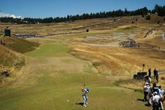 Rickie Fowler of the United States hits his tee shot on the seventh hole during the second round of the 115th U.S. Open Championship at Chambers Bay on June 19, 2015 in University Place, Washington.