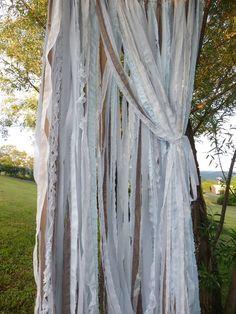 Lace & shredded fabric backdrop.