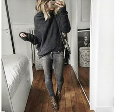 Dark grey jeans and pull over sweater. Boots. Winter fun.