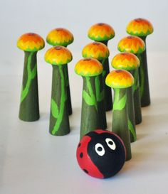 "Wood Sprite SunFlowers with Lady Bug Bowling Set - 10 pin    Each wooden bowling pin (or skittle) measures approximately 3"" and this set comes with a hand-painted Ladybug wooden ball."
