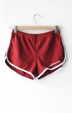 """- Description Details: 'California' contrast trim shorts in red with white contrast side trim and elasticized waistband. Lightweight, form-fitting. Measurements: (Size Guide) S: 26"""" waist, 3.0"""" inseam"""