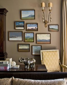 simple landscapes on a brown wall, with sconce.