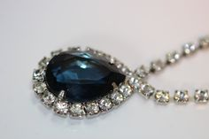Hope Diamond Imitation Necklace 1940's Vintage 565.00 EUR. Glamorous and stunning vintage necklace from 1940's that look so much that Tarvenier Blue (called also French Blue)  diamond which was later disappearing during the French revolution until it emerged to London 20 years later. The famous Hope Diamond is shown at The National Museum of Natural History located in National Mall in Washington, D.C. United States.  In this blue diamond imitation necklace the blue stone is cut in pear…