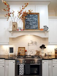 Range hood with a mantle- perfect for a vignette to decorate! :)