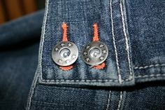 Use a few common household tools to remove the waist button or rivet from your jeans.