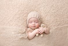 3 month old boy tucked in pose baby in a bonnet snuggling with tiny bear cream beige neutral | Bella Rose Portraits Springfield, VA newborn and baby photographer