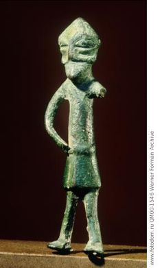 Figurine, probably of Odin. The right eye is depicted as a single line - Odin gave one of his eyes in return for knowledge. Country of Origin: Sweden. Culture: Viking. Place of Origin: Lindby, Skane. Material Size: bronze. Credit Line: Werner Forman Archive/ Statens Historiska Museum, Stockholm . Location: 18.