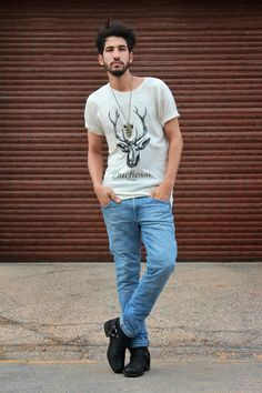 Shop this look on Lookastic:  http://lookastic.com/men/looks/grey-print-crew-neck-t-shirt-and-blue-jeans-and-black-leather-boots/2051  — Grey Print Crew-neck T-shirt  — Blue Jeans  — Black Leather Boots