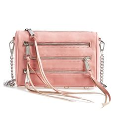 Rebecca Minkoff 5 Zip Crossbody Rebecca Minkoff 5 Zip Crossbody in a beautiful pastel light pink color! New condition, great price!   I'll only consider offers made with the offer button.💰 No trades or low ball offers.🚫 My items are already extremely discounted and sell very fast. So, if you see something you like... make an offer! 😊❤️  Thanks for looking around my closet! I am always adding new items! 💖🎀👗👛👠💄  BUNDLE & SAVE 10%!  Top 10% rated seller// suggested user✨ Rebecca…
