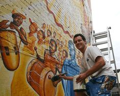 """Joel Bergner and one of his murals, """"The Afro-Colombian Mural: Currulao y Desplazamiento,"""" just off the of U Street NW (Photo: Luis Gomez Photos) Colombian People, Afro, Chalk Art, Street Artists, Graffiti Art, Murals, Cool Pictures, Photos, Painting"""