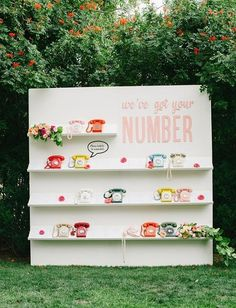 How cool is this retro phone seating wall!? This couple built their long distance relationship via phone, so they incorporated that into their wedding decor in a perfect way.