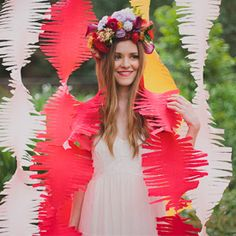 Summe Punch wedding ideas with bright colors, a swing and a crepe paper backdrop!