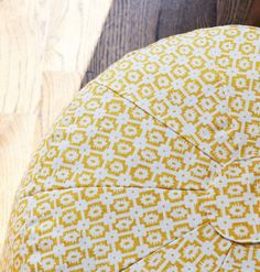 Yellow Patterned Pouf - Whether being used as a nursery ottoman or playroom seat, this sunny yellow pouf is a must-have décor item. #PNshop