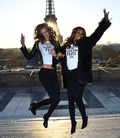 Josephine Skriver & Jasmine Tookes at the Eiffel Tower in Paris promoting the upcoming 2016 Victoria's Secret Fashion Show