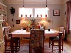 Alicia Paulson's lovely dining room with her SunshineDay afghan draped over a chair - LOVE IT!