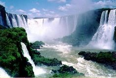 The border between Brazil and Argentina...Iguassu Falls...this one is the Devil's Throat (Garganta del Diablo), w h i c h has a classic horseshoe shape and drops into a deep chasm.