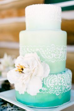 Pretty minty teal cake with a decorative flower