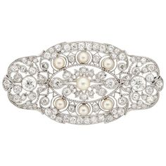 Edwardian Platinum, Pearl and Diamond Brooch  2 old European-cut diamonds ap. .90 ct., 100 old European & old-mine cut diamonds ap. 3.25 cts., 7 pearls ap. 3.8 to 5.0 mm., c. 1915, ap. 10.6 dwts.