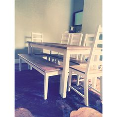 Dinning room table with white Paris chairs and a bench #green #cottage #bench #cowskin #rug