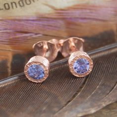 I've just found Tanzanite Rose Gold Birthstone Stud Earrings. These stunning 18k rose gold vermeil earrings feature two 0.25 carat faceted genuine Tanzanite stones set into gently textured bezels.. £89.75