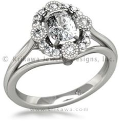 Vintage Scalloped Halo Engagement Ring - This antique-inspired engagement ring has a scalloped diamond or sapphire halo which frames your choice of center stone. Four 1.5mm round accent stones are set in millegrained bezels, with twelve 1.25mm prong-set stones in between (0.17 carat total weight). Your center diamond or colored gemstone is showcased in a four-cutout bezel. This mounting has a split shank, with arms elevating the open gallery and setting. The narrow band …