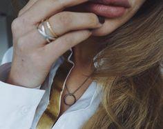 Styling by anniealbertsson showing Infinity Zirconia Ring Gold , Cross Ring Silver and Water lily Triple Zirconia Ring Gold #jewellery #Jewelry #bangles #amulet #dogtag #medallion #choker #charms #Pendant #Earring #EarringBackPeace #EarJacket #EarSticks #Necklace #Earcuff #Bracelet #Minimal #minimalistic #ContemporaryJewellery #zirkonia #Gemstone #JewelleryStone #JewelleryDesign #CreativeJewellery #OxidizedJewellery #gold #silver #rosegold #hoops #armcuff #jewls #jewelleryInspiration…