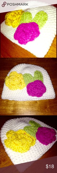 NWOT • Crocheted White Hat w/ Flowers 🌺🌼🍃🌿 Crocheted White Hat w/ big Pink & Yellow Flower 🌺🌼 & Green leaves 🍃🌿 One of a kind - Handmade. Beautiful! NEVER WORN 🎉 BRAND NEW WITHOUT TAGS 🎉 Accessories Hats