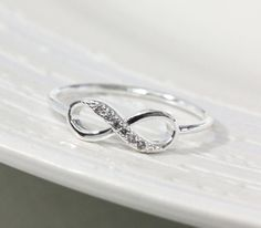 I love this for a wedding ring. It can double as an infinity sign or a 'tying the knot' ring.