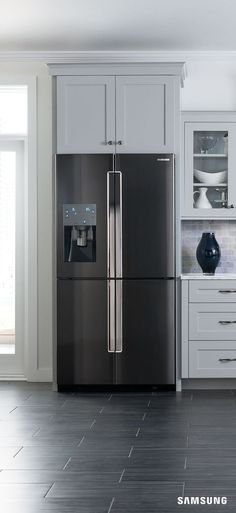 With sleek black stainless steel, this refrigerator makes a striking contrast against white kitchen cabinets and bright backsplash. But really, it'd look right at home in any kitchen (in our humble opinion). Kitchen Cabinet Remodel, Custom Kitchen Cabinets, Grey Cabinets, Glass Cabinets, Cottage Shabby Chic, Shabby Chic Kitchen, Grey Kitchens, Home Kitchens, Small Kitchens