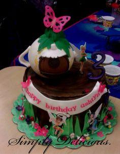 Tinkerbell themed birthday cake. #treestump #tinkerbell #cake