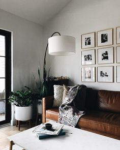love the leather couch with the square framed photos on the wall, all the white with the green plants in the corner Farmhouse Decor Living Room, House Interior, Apartment Decor, Couches Living Room, Living Room Decor Modern, Interior Design Living Room, Home Interior Design, Living Decor, Living Room Leather