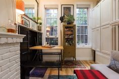 How a New York Couple Lives in 242 Square Feet A table and benches for four fold out of the cabinet at left.