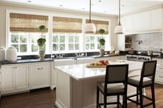i like the dark counters and then white counters on island... plus the windows