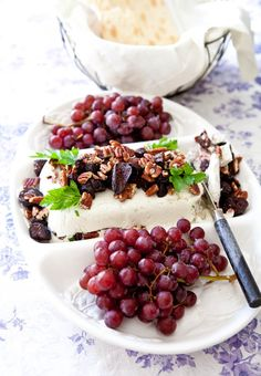Gorgonzola based cream cheese garnished w/ dried fruits & nuts - served with seedless red grapes
