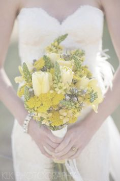 Huffington Post, KLK Photography, desert wedding ideas, boho wedding, wedding trends, flowey fabric, boho headbands, amy michelson, lace dress, lace and feathers, organza dress, wedding, wedding dress, yellow florals, yellow flower, bouquet, wedding flowers