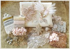 "Valentine ""Stash kit"": 24"" x 18"" Ivory 100% Wool Felt, 2 Taupe Chiffon Rose and Leaf Appliques (1 Large, 1 Small), Pair Softest Pink Feather Angel Wings, 3 Ceramic Rosebud Beads, Rhinestone Heart Buckle, Large Mother-of-Pearl Pendant Disc, 6 Yards Dyed Seam Binding, 2 Yards Pink Mini-PomPom Fringe, 5 Yards Metallic Gold String, 2 Yards Silver Fringe Trim,1 Yard Embroidered Rose Lace Trim, Gorgeous Bead and Rhinestone Starburst Pin, Large Sequin and Organza Embroidered Heart Applique, etc."