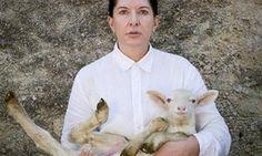 Marina Abramovic with white lamb