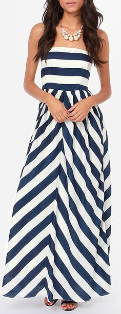 Clever use of bold heavy weight stripes to create a sense of figure. The horizontal bodice gives boost to the bust (rather small on this model) and the diagonal matched up patten on the skirt draws the eye to create a flattering A-line.   Would also work well on a finer stripe. Gotta get those patterns to match though, otherwise this would look disastrous.