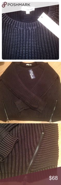 NWT Olive & Oak Black Ribbed sweater with zippers NWT! Chunky knit crewneck sweater with zippers on each side. Edgy yet cozy comfy! 100% cotton. Color is a muted black. Olive & Oak Sweaters Crew & Scoop Necks