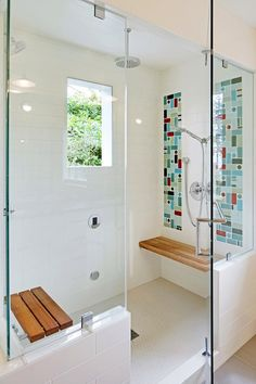 I like the walk in shower and the benches. Not so much the tiles itself. Would change to something more muted.