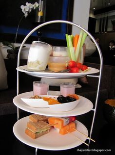 A healthy afternoon tea. dried fruit and nuts crudietes and dips fruit sticks