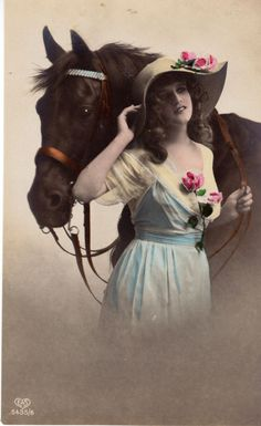 This lovely photo is part of a series of six images taken of this beautiful young woman and her handsome horse. Interestingly, her dress is hand tinted in different colors depending on the image.