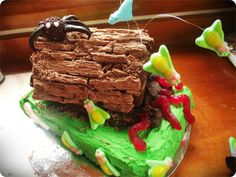 """Creepy Crawlies on a log""  birthday cake (step by step instructions)"