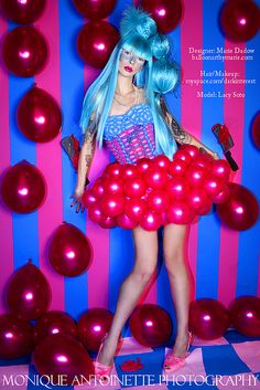 "Balloon dress. Linking instantly into the ""used household"" theme as the typical designer would not think to use balloons for a dress. It creates the fun and colourful side to the theme."