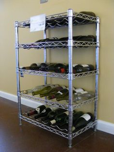 """Chrome Wire Wine Rack in The_Shelving_Store's Garage Sale in Madison Heights , MI for $101.99. We are selling one our best products, a chrome wire wine rack. This unit is 14""""d x 24""""w x 34""""h. There are 5 shelves that hold 6 bottles each for a total of 30 bottles. This is an incredibly sturdy and durable product that is commercial quality. Please contact Amy Knowles or Joan Aiello at 248.547.2400 or Aknowles@shelving.com for more information. Please visit our showroom in Madison Heights or ..."""