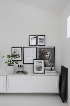 Monochrome picture wall with black frames fro Elisabeth Heier