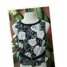 """Black & White Floral Top Petite floral tank top with accent belt in the front and back zipper, 21"""" inches long, spandex /cotton fabric great with a skirt, jeans or your favorite slacks 22"""" inches across the front bust measurement only the fabric has a lot of stretch. Making it 44 around front to back. Prophecy  Tops Tank Tops"""
